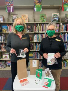 photo of library staff with craft kits