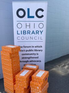 photo of boxes and OLC banner