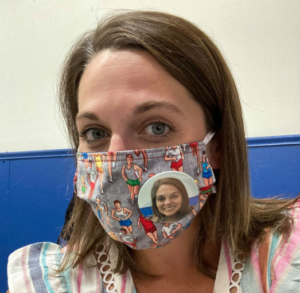 woman wearing mask with smile on button photo