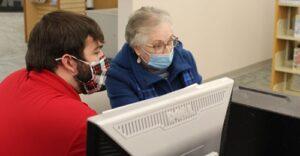 Senior using computer at library photo
