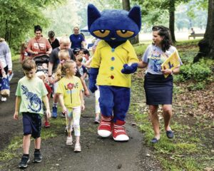 photo of people walking with Pete the Cat character