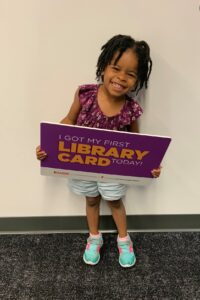 photo of girl with library card