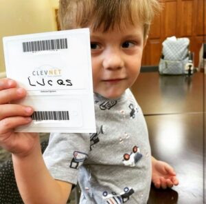 boy with library card